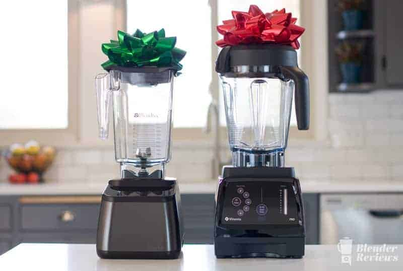 A Blendtec and a Vitamix with bows on top